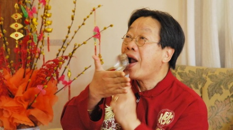 TRAN QUANG HAI PLAYS THE SPOONS , HCM CITY, VIETNAM, 2011